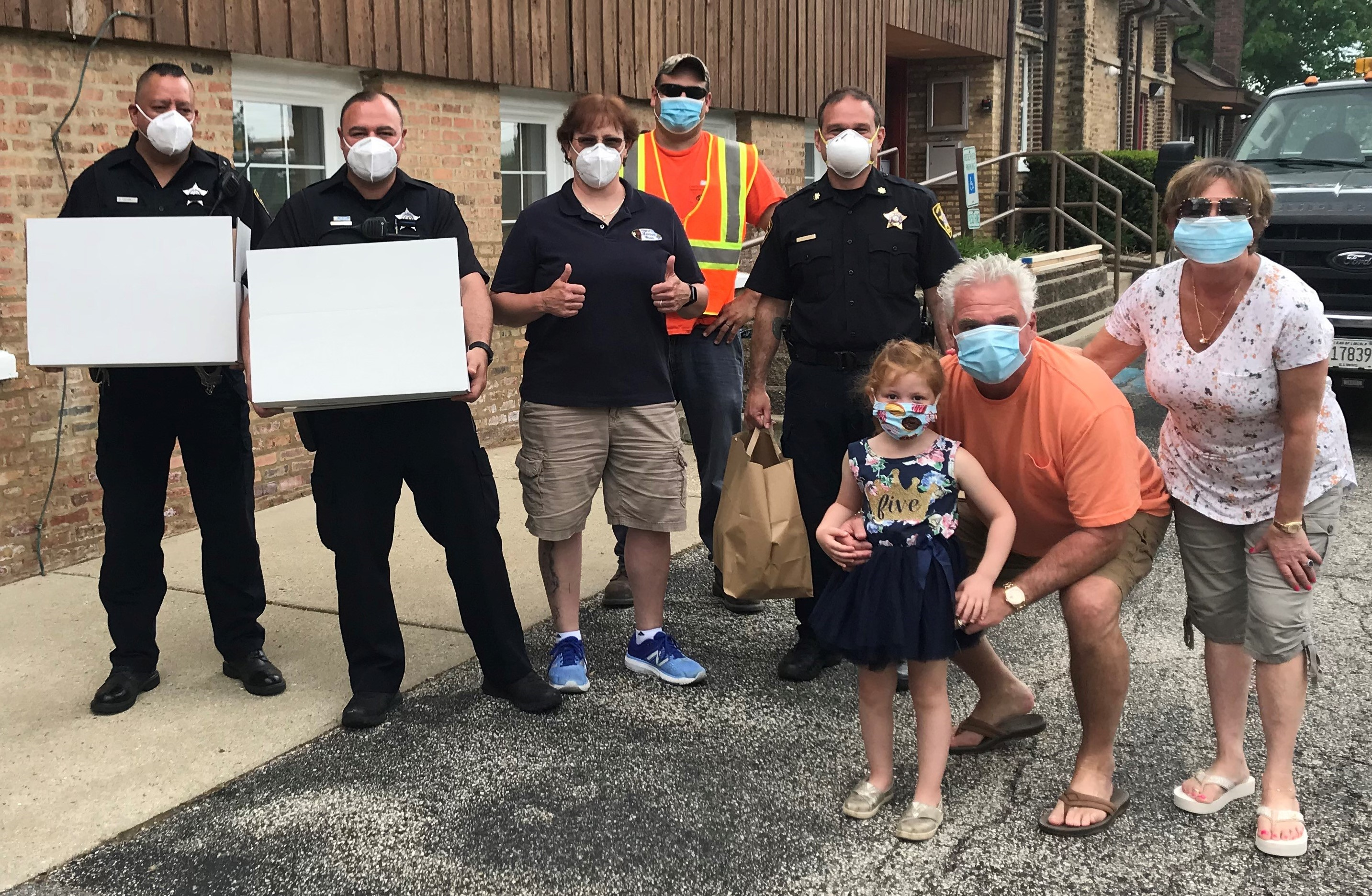The Krumwiede family giving first responders boxed lunches